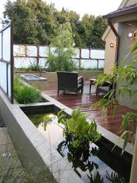 exterior design charming backyard pond ideas with brick paving