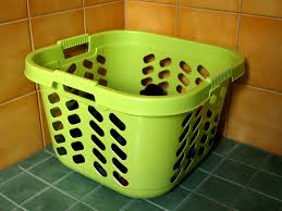 file clothes in green laundry basket jpg wikimedia commons