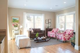 living room feng shui layout with red sofa and elegant wall paint
