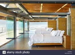modern hotel beds in a row open to patio stock photo royalty free