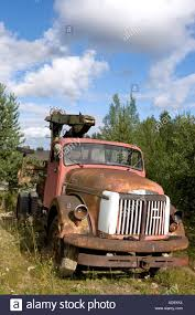 red volvo truck old red volvo truck abandoned to backyard finland stock photo