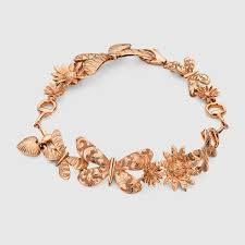 from our gucci flora collection this gold bracelet has a