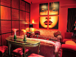 the room looks warm i like the painting on the wall red