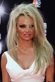 pixie to long hair extensions pamela anderson ditches pixie cut for long hair extensions