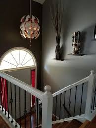 Foyer Artwork Ideas How To Decorate A Two Story Foyer Tall Ceilings Foyers And Ceilings