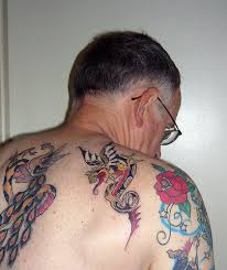 mythological fantasy dragon small and large back piece tattoo