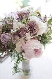 wedding flowers near me beautiful bouquet of pale pink and purple colored roses peonies