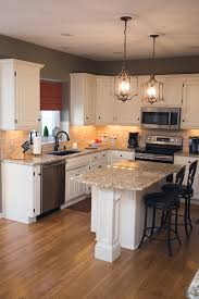 traditional kitchen white cabinets giallo ornamental granite