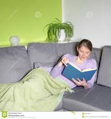 woman relaxing reading on a sofa stock image image 30464059
