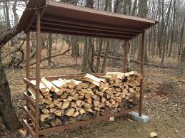 simple diy backyard firewood storage shed with roof and cinder