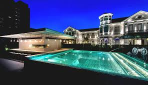 amazing view of mansion with pool at night great lighting viewing
