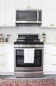 First Home Renovation White Quartz by Before U0026 After Our Kitchen Renovation U2014 Mix U0026 Match Design Company