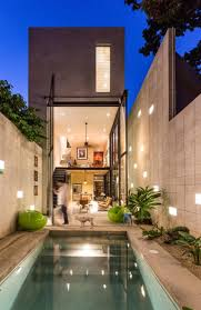 raw house maximizing vertical space and light on a narrow lot