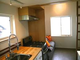 man rebuilds salvaged trailer into 200 sq ft tiny home sells it