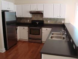 love the slightly darker red tone floor with the white cabinets