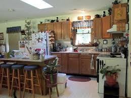 Decorations On Top Of Kitchen Cabinets Decorating Top Of Kitchen Cabinets Dos And Don Ts