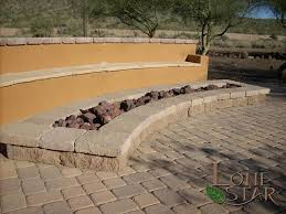 Belgard Fire Pit by Belgard Celtik Fire Wall And Mega Bergerac Fire Pit With Bench In