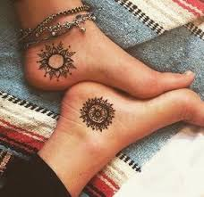 sun and moon tattoos in henna style for couples henna style