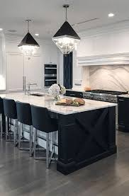 black kitchen cabinets with white countertop 25 trendy contrasting countertops for your kitchen digsdigs