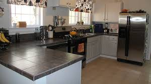 is it better to refinish or replace kitchen cabinets should i replace or refinish my countertops which is the