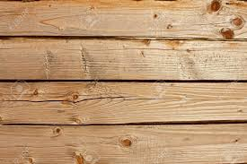 horizontal parallel wooden old logs part of wooden house walls