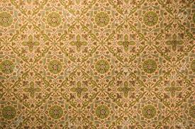 Washed Out Colors - vintage wallpaper with rosettes washed out colors stock photo