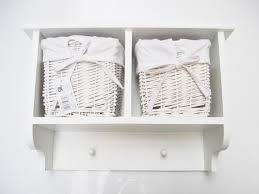 Basket Storage Shelves by Small White Wall Shelf With Hooks And Basket Storage Decofurnish