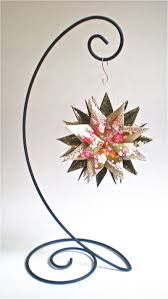floral pink on black and gold paper with ornament stand