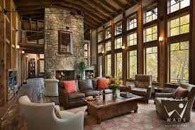 living room toward fireplace and windows looking out to fall color