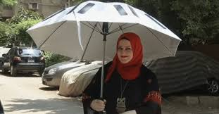 a solar powered umbrella helps muslims stay cool connected during