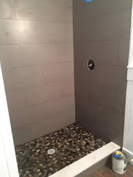 wood look tiles and river rock installation in atlantic