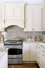 backsplash with white kitchen cabinets grey glass subway tile backsplash and white cabinet for small