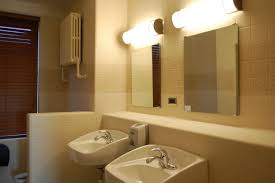 interior framed bathroom vanity mirrors outside fireplace