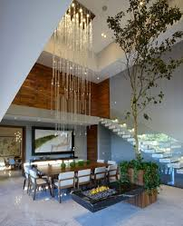 house and home design blogs modern atrium house with large double height space living room by