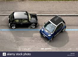 smallest cars smallest motor cars mini cooper and smart next to each other on