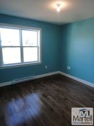 i like the dark floors for the bathroom with the blue walls and