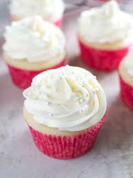 almond cupcakes with whipped almond buttercream frosting stuck