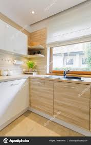 white and wood kitchen with cabinets u2014 stock photo photographee