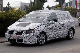 vw minivan spy shots vw to top off new golf range with plus minivan