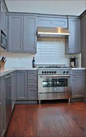 painting above kitchen cabinets kitchen how to stain kitchen cabinets cream kitchen cabinets