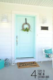 painting your front door the easy way the diy village how to paint an exterior door four easy steps for curb appeal