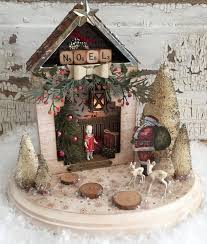 richele christensen create a magical assemblage piece for the holidays filled with special treasures the little deers watching santa deliver presents to the little girl in her