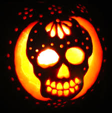 a sugar skull day of the dead pumpkin carving by day and by night