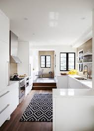modern black and white kitchen create drama with black carpets and rugs