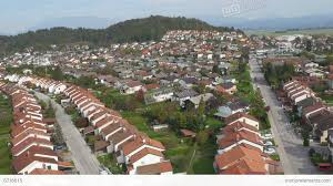 aerial suburban row houses in sunny neighborhood stock video