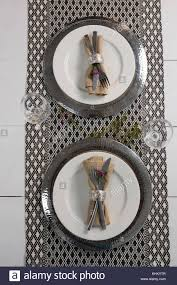 table setting placemat overhead of elegance table setting with wine glasses on placemat