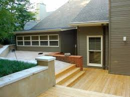 how to landscape a sloping backyard diy plus deck ideas for uneven