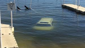 driver backs up cadillac escalade into florida lake tulsa u0027s 24