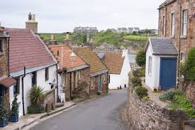 free stock photo of little houses on empty road in crail scotland