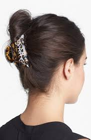 claw hair fashionable vertical updo with claw clip and accessories